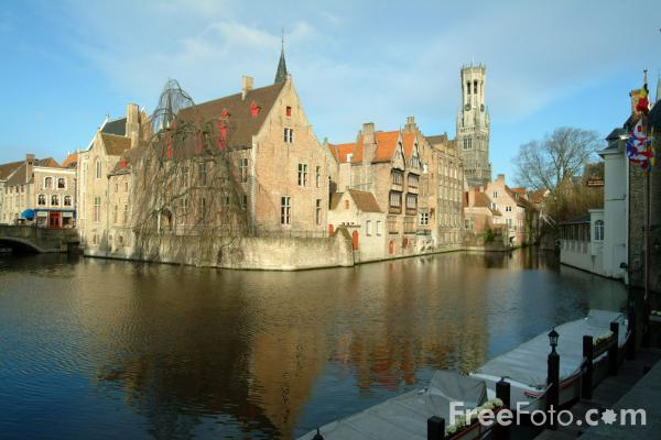 Picture of Medieval buildings reflected in the River Dijver, Bruges, Belgium - Free Pictures - FreeFoto.com