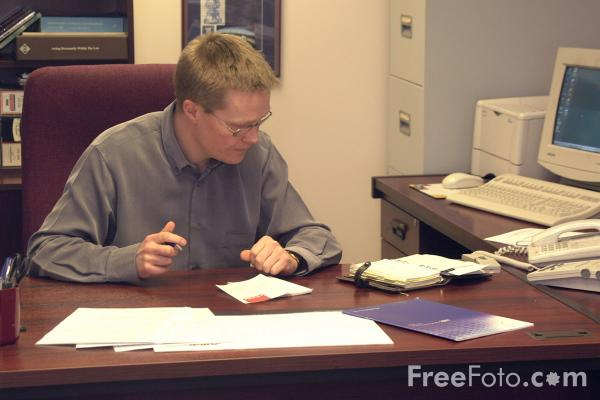 Picture of At work in the Office - Free Pictures - FreeFoto.com
