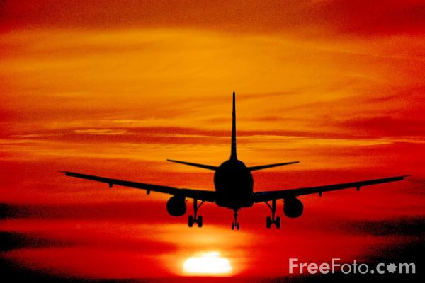 Picture of Aircraft landing into Sunset - Free Pictures - FreeFoto.com