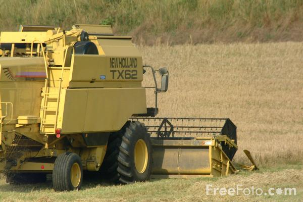 Picture of A combine harvester at work - Free Pictures - FreeFoto.com