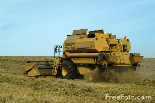 Picture of Combine Harvester at work - Free Pictures - FreeFoto.com