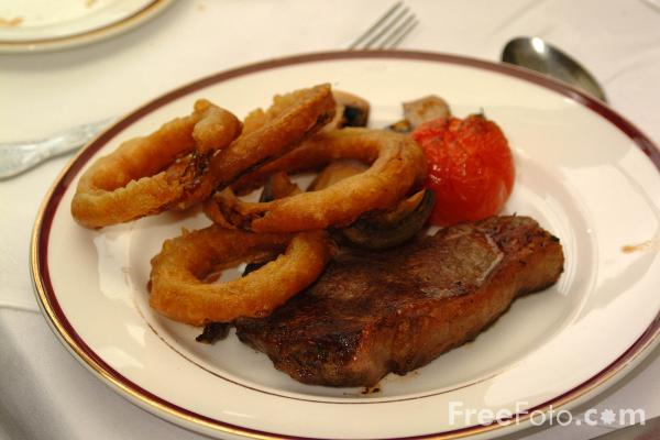 Picture of Steak and Onion Rings - Free Pictures - FreeFoto.com
