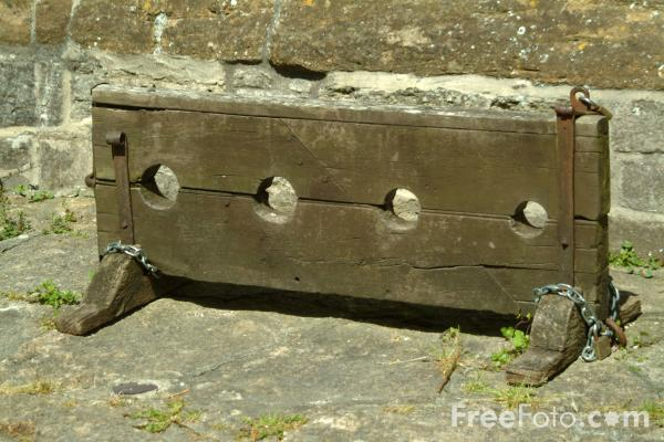 Ancient stocks, Cerne Abbas, Dorset, England pictures, free use image, 1012-42-3 by FreeFoto.com
