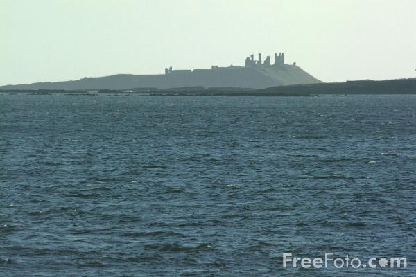 Picture of Dunstanburgh Castle seen from Beadnell - Free Pictures - FreeFoto.com