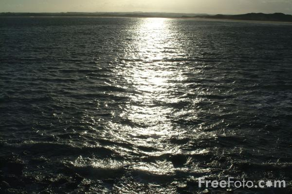 Picture of Sunlight reflected on the sea, Beadnell - Free Pictures - FreeFoto.com