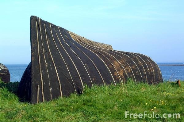 Picture of Upturned fishing boat used as a work shed, Holy Island - Free Pictures - FreeFoto.com