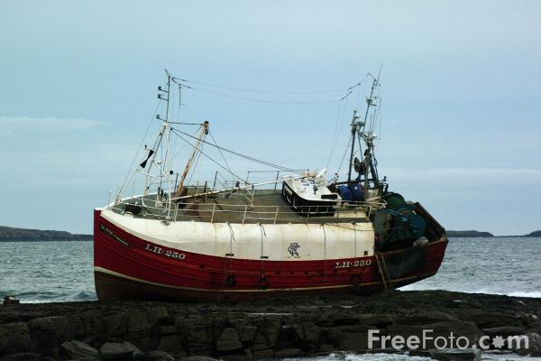 Picture of Fishing Boat Rose Of Sharon on the rocks, Seahouses - Free Pictures - FreeFoto.com