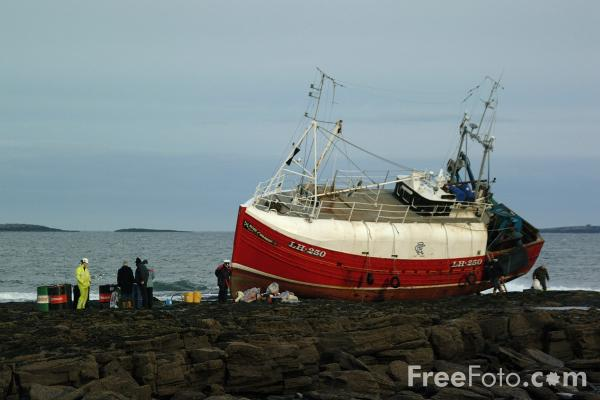 Picture of Fishing Boat on the rocks, Seahouses - Free Pictures - FreeFoto.com
