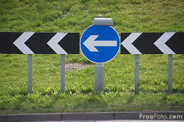 Picture of Turn left road sign - Free Pictures - FreeFoto.com