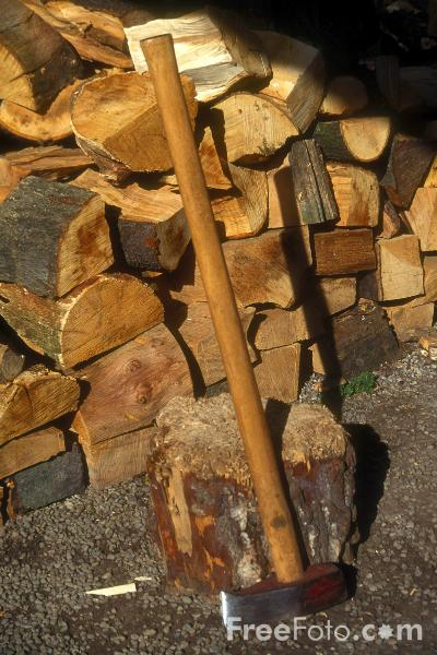 Picture of Wooden Logs and Axe - Free Pictures - FreeFoto.com