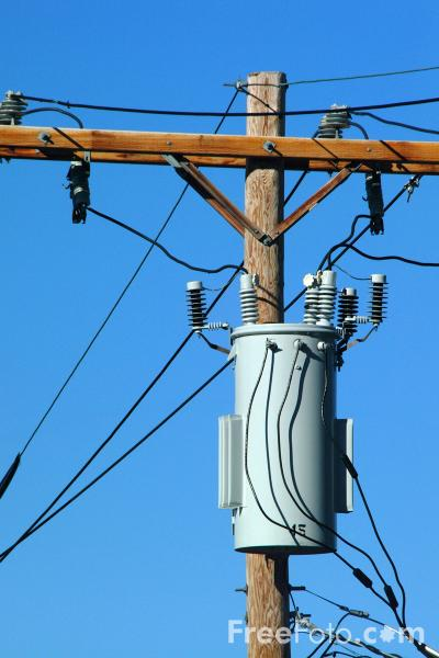 Picture of Electricity Transformer mounted on a Utility Pole - Free Pictures - FreeFoto.com