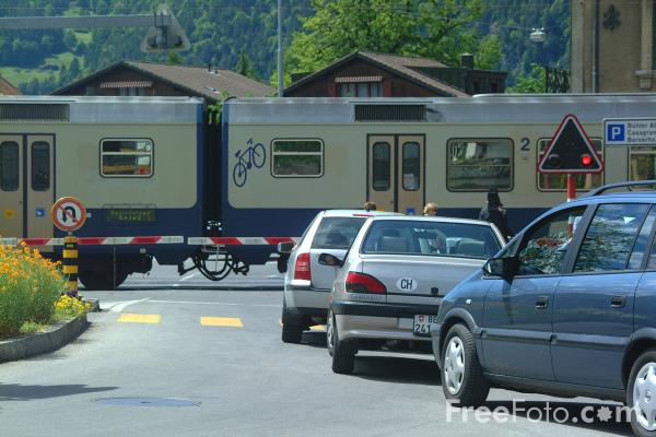 Picture of Railway Level Crossing, Bahnhof Strasse, Interlaken, Berner Oberland, Switzerland - Free Pictures - FreeFoto.com