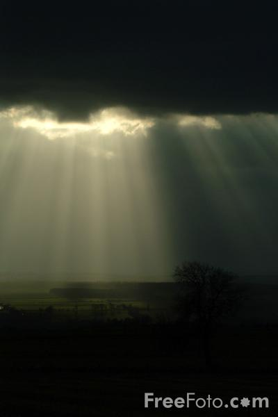 Picture of Rays of Sunshine against a dramatic black sky - Free Pictures - FreeFoto.com