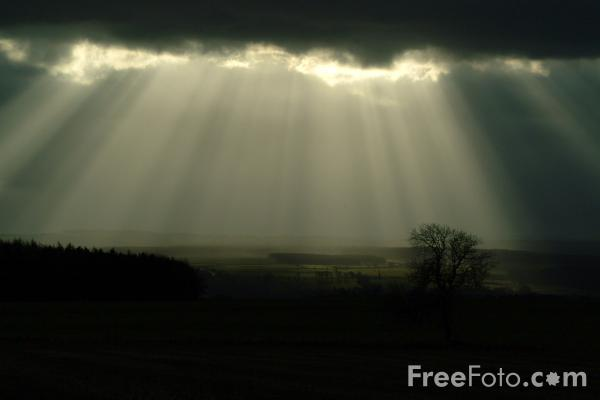 Picture of Rays of Sunshine against a dramatic black sky - Free Pictures