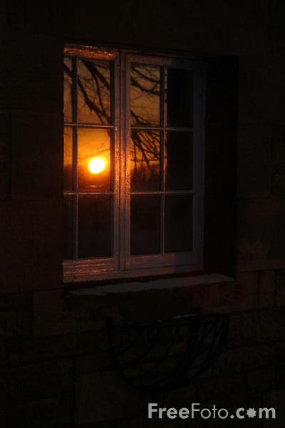 Picture of Sunrise reflected in a Window - Free Pictures - FreeFoto.com