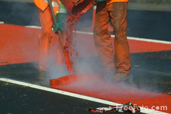 Picture of Red and white road lining work - Free Pictures - FreeFoto.com