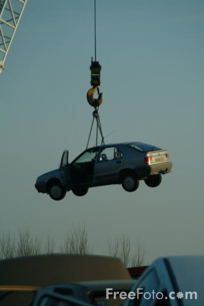 Picture of Scrap car hanging by a wire - Free Pictures - FreeFoto.com