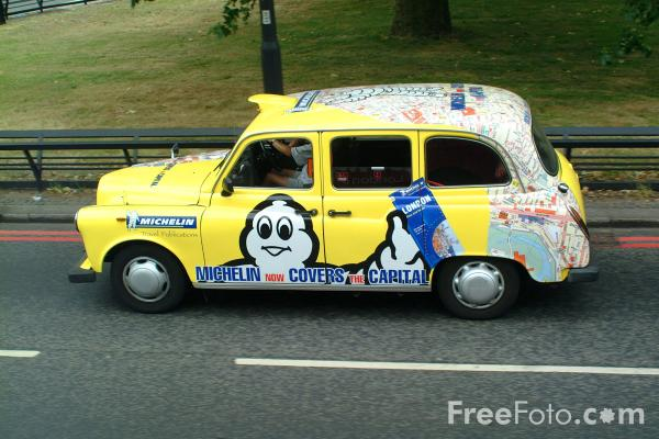 Picture of Yellow Black Cab, London - Free Pictures - FreeFoto.com