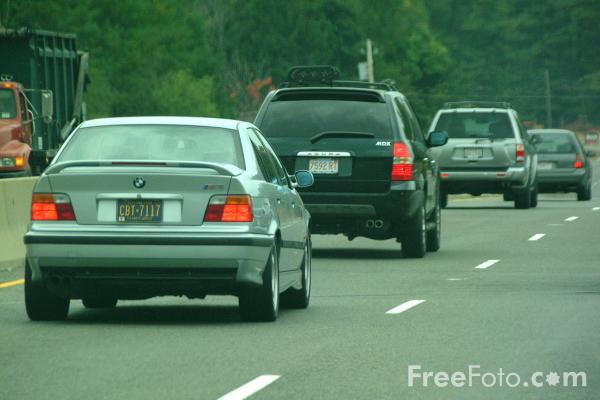 Picture of Automobiles on a Single-carriageway road in Massachusetts - Free Pictures - FreeFoto.com