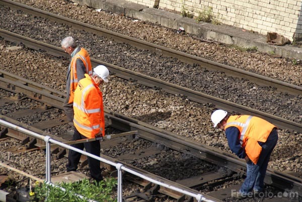 Picture of Engineers inspect damaged railway track - Free Pictures - FreeFoto.com