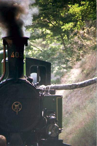 Picture of Mallett 030+030 Steam Locomotive Number 403 takes water - Free Pictures - FreeFoto.com