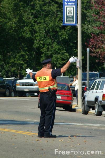 Picture of Policeman Directing Traffic - Free Pictures - FreeFoto.com