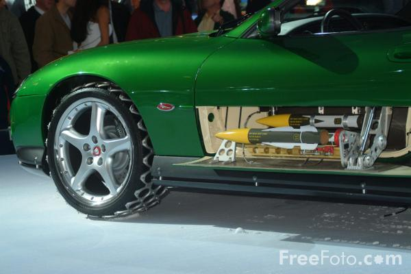 Jaguar xkr roadstar as driven by bond nemesis zao for What is a motor vehicle bond