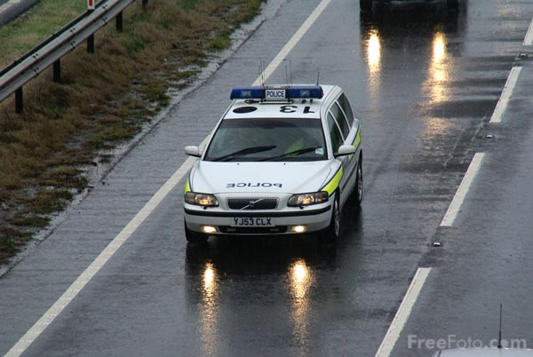Picture of Police Traffic Patrol in the rain - Free Pictures - FreeFoto.com