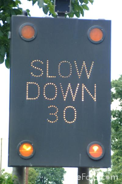 Picture of Slow Down Sign - Free Pictures - FreeFoto.com