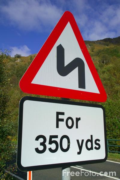 Picture of Series of Bends Ahead Road Sign - Free Pictures - FreeFoto.com