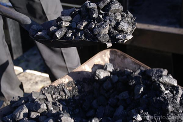 Picture of Shoveling Coal - Free Pictures - FreeFoto.com