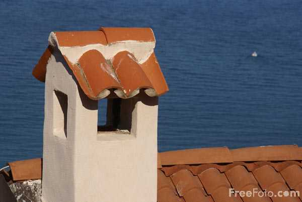Picture of Chimney and tiled roof - Free Pictures - FreeFoto.com