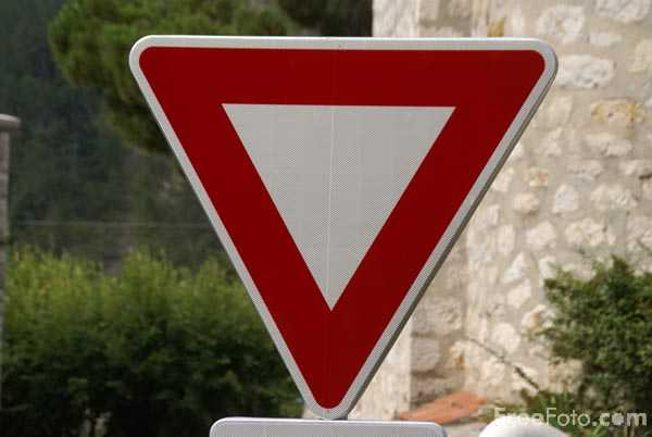 Picture of A triangle road sign - Free Pictures - FreeFoto.com